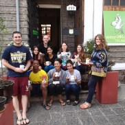 The Feb13 volunteer group outside the hostel where the conference was held