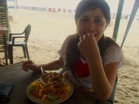 Enjoying some ceviche (with chifles, or fried plantain chips) on the beach